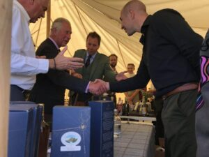 HRH, The Prince Charles shaking hands